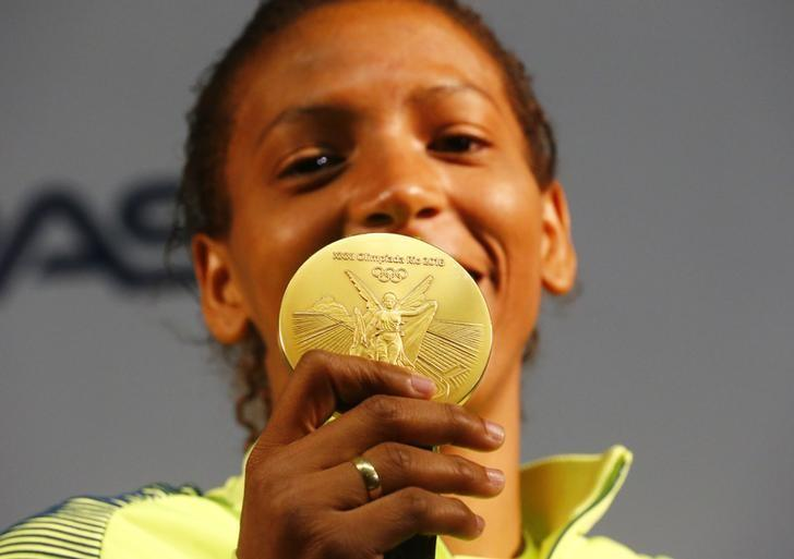 Rafaela Silva holds her gold medal during a press conference