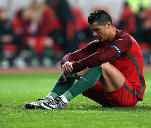 Portugal's Cristiano Ronaldo racts after failing to score a penalty during a friendly soccer match between Portugal and Bulgaria in Leiria, Portugal, Friday, March 25 2016. (AP Photo/Armando Franca)