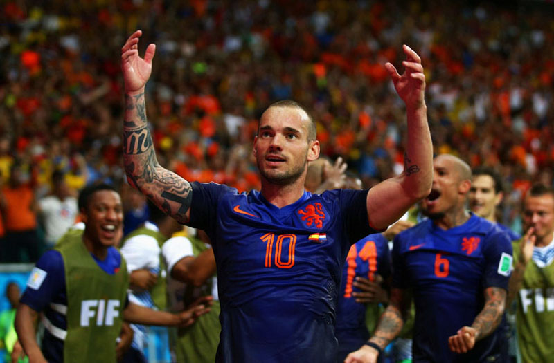 wesley-sneijder-celebrating-netherlands-5-1-win-over-spain-in-2014-world-cup